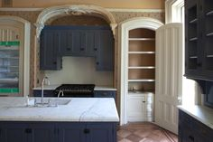 The clients of this 1870s brownstone wanted the new work and decorating to be sympathetic to the patina of age it had acquired over the years. The library became a kitchen, but we endeavored to make the built-in cabinetry compatible with its formal surroundings. We recessed the refrigerator into a closet and panel it to match the existing door. The other closet in the room had a hidden built-in sink that can serve as a bar or vegetable sink with pantry storage above.   nastasivaildesign.com