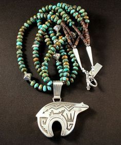 Sterling Silver Navajo Bear Pendant with 3 Strands of Kingman Turquoise Rondelles, Pen Shell Heishi and Sterling Silver #turquoisejewelry