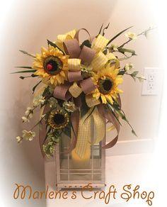 This stunning Spring/Summer Sunflower Lantern Swag / Lantern Bow is pictured on…