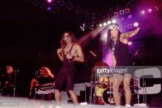 Pop duo Milli Vanilli, with Fab Morvan and Rob Pilatus (1965 - 1998), perform onstage, Chicago, Illinois, July 8, 1989.