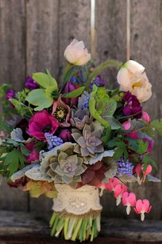 April :: hellebore, poppy, ranunculus, anemones, tulips, bleeding heart, muscari, and succulents.  Stems wrapped in burlap and a piece of lace from the bride's dress.