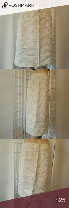 Tan and white floral skirt with slit Tan and white floral skirt with slit   Villager by Liz Claiborne   Has a side zipper  Excellent condition like new no flaws  Material content  Shell: 55% linen 45% cotton  Lining: 100% polyester   Measurements aprox  Waist 30in Length 22.5 Villager by Liz Claiborne  Skirts