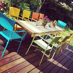 @ohkoey gets creative with colorful #Pier 1 Stacking Armchairs and an #upcycled pallet table. 🌻 Let your imagination run wild by shopping our outdoor Stacking Armchairs via our Like2b.uy/Pier1 link in our Instagram profile.