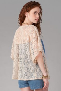 "Add a soft feminine touch to your look with the Carmona Lace Kimono. A cream colored lace makes up this roomy kimono.  Style over a romper with a pair of wedges for the perfect look. <br><br> -	25"" length from shoulder to hem <br> -	Measured from a small<br><br> -	100% polyester<br> -	Hand Wash<br> -	Made in U.S.A.<br>"