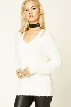 A fuzzy knit sweater featuring an open-shoulder design, V-neckline, long sleeves, and a boxy silhouette.