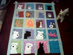 Dog Quilt - almost completed (Lily pictured with quilt -- her square is the top left with pink background)