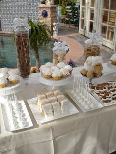 This was actually for a baptism, but the white treats make great favors for a communion. Baptism Party Decorations, Baptism Favors, Baptism Food, Communion Decorations, Baptism Ideas, Comment Dresser Une Table, Buffet Dessert, Candy Buffet, Candy Jars