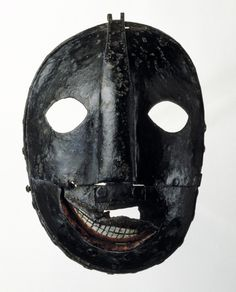 17th-18th century iron executioner's mask, Tower of London exhibit. The smile was a nice touch.