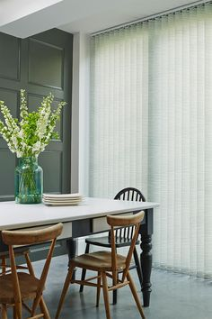 Use wooden furniture, plants and window dressings to add texture into a room. Made to measure Alba Emerald vertical blind creates texture as well as adding a slight touch of green. Great for dining rooms and kitchens. House Blinds, Blinds For Windows, Door Shades, Kitchen Seating, Home Organization Hacks, Sliding Glass Door, Wooden Furniture, Window Dressings, Sweet Home