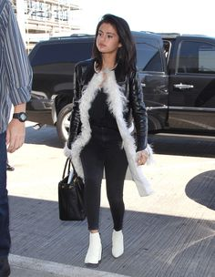 April 28: Selena boarding a flight at LAX airport in Los Angeles, California