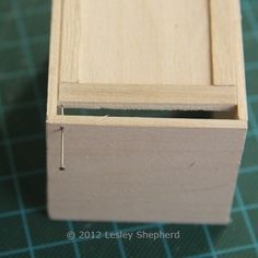 How To Make Working Base Cabinets for a Dollhouse Kitchen: Fit the Lower Hinge Pin Into the Kitchen Base Cabinet and the Door