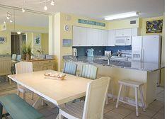 Coastal kitchen with blue glass subway tile
