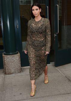 Kim Kardashian in a green lace dress.