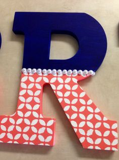 How I painted my baby girls nursery letters. Navy blue and coral with pearl accents. I'm obsessed!!