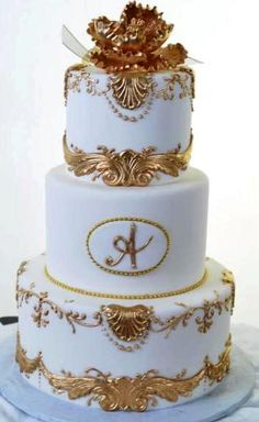 Pastry Palace Las Vegas - Wedding Cake #708 - Simply Golden.  Round white tiers with gold accent, trim, and peonies.
