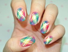 Multi colored plaid nail art design. The design uses a variety of bright colors such as yellow, green, orange, red, violet and blue for that fun and crazy effect.