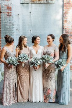 Photographed by Ashley Largesse, this New England industrial chic wedding was full of soft shades of sage, slate blue and tan - with pops of gold for a modern touch!