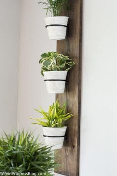 This vertical farmhouse style planter is an easy DIY thats perfect for a dining room, living room or kitchen