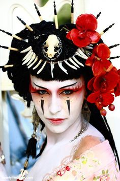 She reminds me of some sort of post-apocalypse geisha, all blossoms and bones. Fascinating mix!