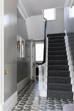 The walls in the hall are painted in 'Hardwick White' gloss by Farrow & Ball; the carpet on the stairs and in the main bedroom is 'Häggå' by Kasthall grey lacquer walls foyer stairway Grey Hallway, Tiled Hallway, Victorian Hallway, Victorian Terrace, Hallway Paint Colors, Color Walls, Grey Walls, Decoration Hall, House Entrance