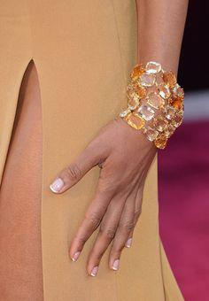 Naomie Harris: Naomie Harris wrapped a gorgeous citrine and diamond H. Stern bracelet around her freshly manicured hand at the 2013 Oscars.
