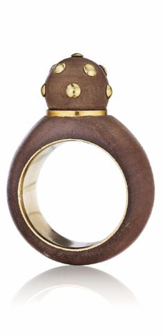 BOIVIN A Wood and Gold Ring , 1960's Designed as a carved wood bombé ring, centering on a carved wood sphere accented by polished gold appliqués, mounted in 18K yellow gold. With jeweler's marks and French assay marks