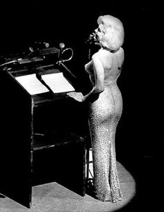 May 19, 1962 Madison Square Garden  Marilyn Monroe's famous nude encrusted with rhinestones dress sold for $1,267,500 after her death.  Still holds the record for the most expensive dress sold today.
