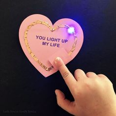 Valentine STEM: Light-Up Circuit Valentines Build a light-up Valentine with this free conversation heart printable, electric paint & LED's. Great STEM activity for aspiring electrical engineers. Science Valentines, Kinder Valentines, Valentine Day Boxes, Valentine Activities, Valentines Day Party, Valentine Day Crafts, Stem Activities, Holiday Activities, Kindergarten Activities