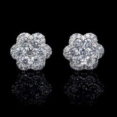 This gorgeous pair of white gold cluster flower earrings, feature 62 round brilliant cut white diamonds of F color, clarity and excellent cut and brilliance, weighing carats total. We are located in the heart of the jewelry district in Manhattan. Cluster Earrings, Flower Earrings, Gemstone Earrings, Diamond Earrings, Pendant Necklace, Diamond Studs, Diamond Pendant, Diamond Jewelry, Gold Jewelry