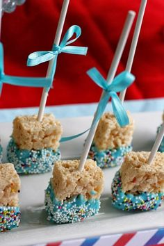 Quick snack! Dip some rice crispies in light blue chocolate with sprinkle dots. More