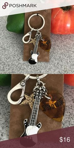 """*LUCKY BRAND Ornate Key Chain with MULTI CHARMS* *LUCKY BRAND Ornate Key Chain with MULTI CHARMS* ****FEATURES:**** ...Retired Item, STOCKING STUFFER, and Unusual Piece ...Decorative ring holds these beautiful CHARMS ...Done in Antiqued Silver and Brass metal ...Charms are very decorative; Hammered Brass Star, Small Silver Star, Tortoise Shell Guitar Pick      with the word """"LUCKY"""" in black and a Large Enameled ELECTRIC guitar ...Lobster Claw Charm states """"Made With Peace and Love"""" ...ENTIRE…"""