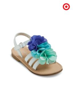 Picked especially for your trendy little gal, these Cherokee Joslyn Sandals will have her strollin' in style. These baby- and toddler-approved sandals feature a flourish of fun gradient flowers of blue, teal and mint—who wouldn't love the cool colors?!