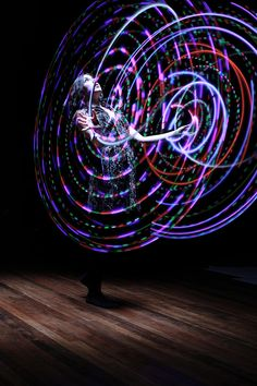 Myself, with two LED hula hoops. photo by Silas Chipelski, editing by me.