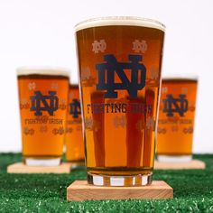 These pint glasses are the most spirited way to drink your fermented nectar of choice short of dog-lapping it straight from the cupped paws of your school's mascot.