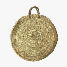 Our classic Natural Straw Round French Tote is made from hand woven palm leaves with handles. Perfect as an everyday carryall.