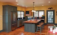 Wood cabinets with yellow walls - Google Search