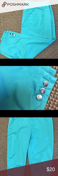 "Chico's size 2 clamdiggers Turquoise green Stretch cotton just below the knee Capris. Chico's size 2 = 12-14. Buttons at sides of knees as accents. Faint spot on lower leg - see pic. Lightweight. 37"" waist 26.5"" inseam 10"" rise. Chico's Pants Capris"