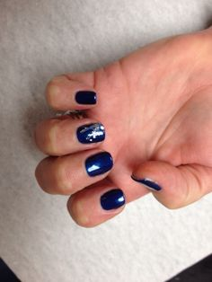 Navy with light blue white and silver glitter design on accent nail Oasis Salon and Spa Mill Hall Pa (570)726-6565