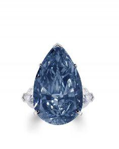 The BLUE ICE: a rare 22.02ct GRAFF Fancy Deep Blue diamond ring, set with pear shape diamond shoulders.
