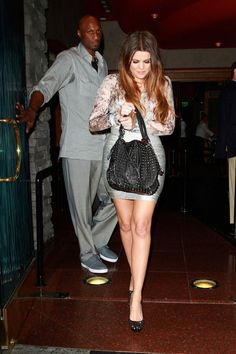 """Khloe Kardashian Photos Photos - Khloe Kardashian rocks a skintight silver skirt as she leaves Mastro's Steakhouse in Beverly Hills. Khloe dined with husband Lamar Odom along with brother Rob and his """"DWTS"""" dance partner Cheryl Burke after their premiere performance on the show. - Khloe Kardashian rocks a skintight silver skirt as she leaves Mastro's Steakhouse in Beverly Hills"""