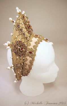 Athena--light gold faille, gold-toned trim and cord, cream freshwater pearls in various shapes and size, swarovski rhinestones and crystals, metal findings. French hood by Michelle Fennema, 2015.