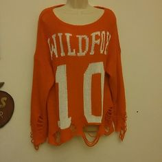Wildfox sweater Authentic wildfox over sized sweater size small in excellent condition. All the distressing is how the sweater is manufactured. I bought it from another posher who described it as red, but it is clearly orange which just does not look good on me! I wish it was red because I love the look, the style, the feel & the fit. Please use offer button to negotiate. No holds. Wildfox Couture Sweaters Crew & Scoop Necks