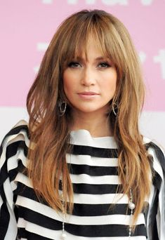 The most *gorgeous* long hairstyle with bangs! Jennifer Lopez:  An all-over highlights look punctuated by J.Lo's eye-grazing strands.