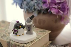 Love Penguin and Shark wedding cake topper #cakedecor #oceanwedding