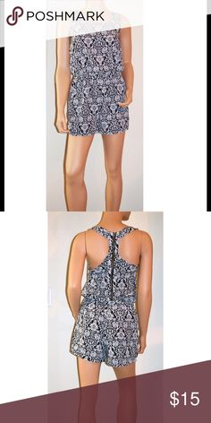 Black and White Print Romper Black and white print romper. 100% Polyester. Hand Wash. True to size. Phanuel Pants Jumpsuits & Rompers