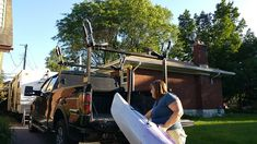 We had kayak carrying well in hand with the Sequoia. Kayak Rack For Truck, Tonneau Cover, Blue Flames, Canoe, Us Travel, Kayaking, Boat, Trucks, Pocket