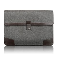 TUMI  DREXEL ENVELOPE BRIEF  €132  New portfolio from Tumi is a mix of classic silhouettes with retro-inspired crafts for business and travel accessories. Contains the finest leathers and fabrics with artisanal craftsmanship that shows Tumis commitment to the highest quality.