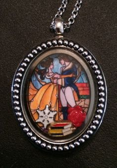 Beauty and the Beast, Living Locket. Hey, I found this really awesome Etsy listing at https://www.etsy.com /listing/183743924/beauty-and-the -beast-themed-locket