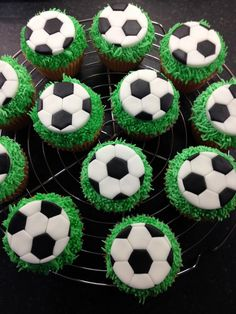 Football cupcake toppers on buttercream grass.