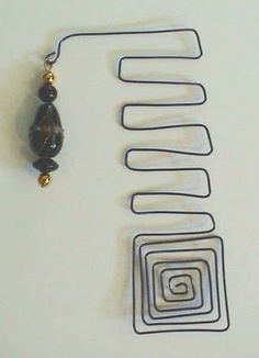 Wire bent different ways (heart, star), beads -- book mark